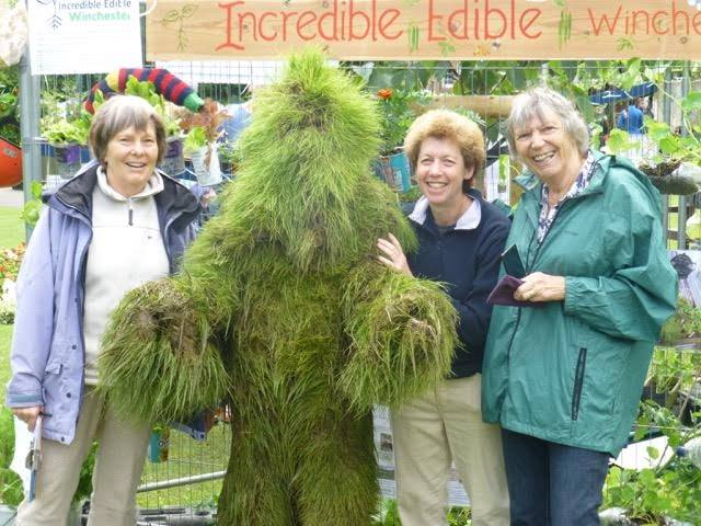 Team members with the green man